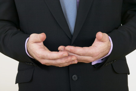 1 person: close up of businessman gesturing with his hands, Mid-adult man, 40-49 years, Caucasian ethnicity,1 person