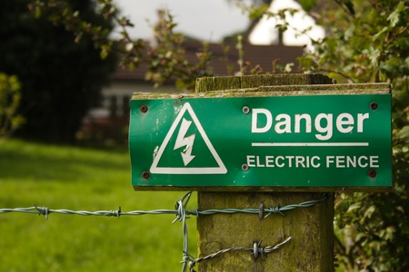 electric fence: Danger! electric Fence sign Stock Photo