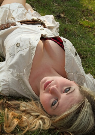 Beautiful and sexy blonde model posing in field Stock Photo - 9870830