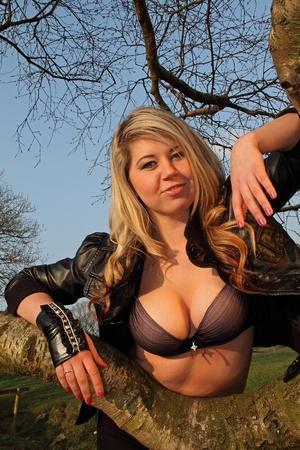 Beautiful and sexy blonde model posing in black bra