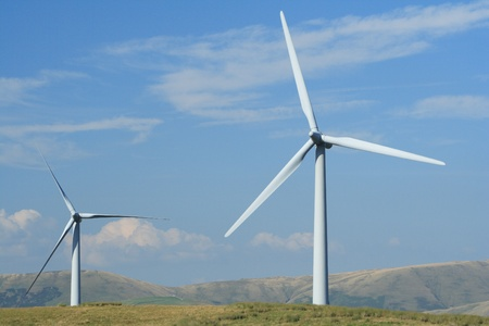 Wind turbines against blue sky. Shot in English Lake District, UK