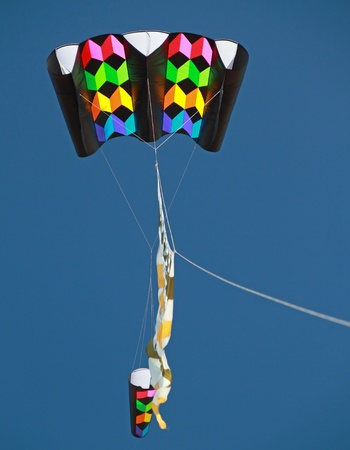 Colourful Kite against clear blue sky Editorial