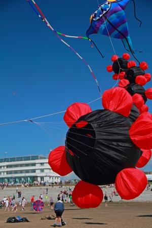 Black and Red kites flying at Morecambe Kite Festival, Lancashire, UK Editorial