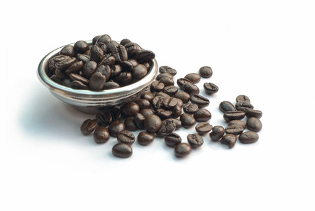 Coffee beans with basket on white background
