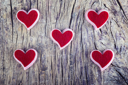 red hearts on old textured wood