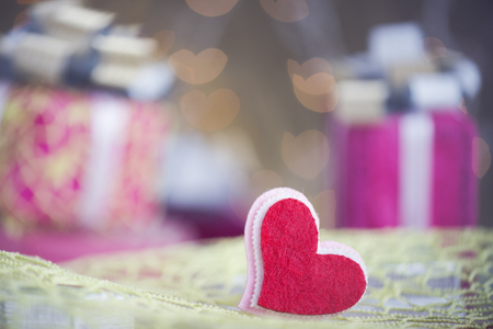 Heart with present in background Stock Photo