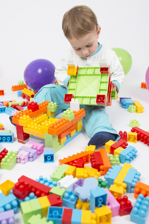 Cute little boy playing with his bulding blocks