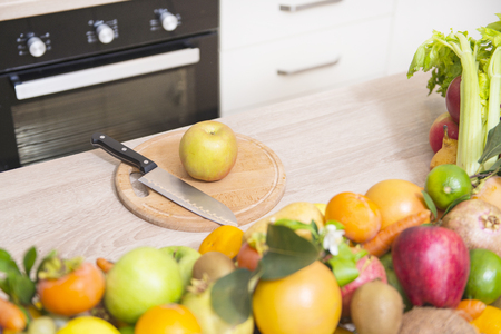 various fresh fruits on kitchen board Stock Photo