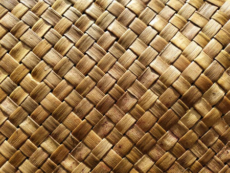 gold cross-patterned bamboo seated mat photographed during the day outdoor Imagens