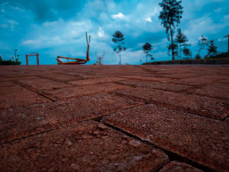 Close up photo of block paving floor with sports equipment background with blur background method