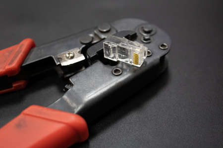 making crimp for ethernet network rj45 wire with crimping tool. step by step process