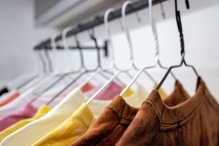 fashion casual t-shirts hanging at store place. colorful choice for buy clothes Stock Photo