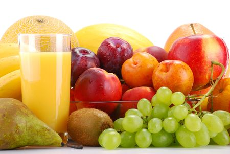 fruit salads: Composition with fruits and glass of orange juice