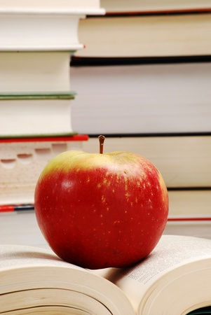 Composition with hardcover books and apple photo