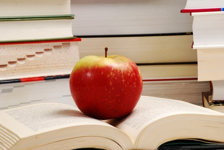hardcover: Composition with hardcover books and apple