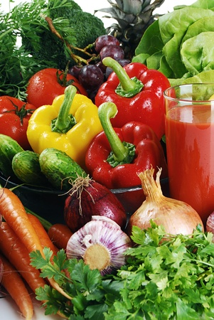 digest: Composition with variety of raw vegetables and glass of juice Stock Photo