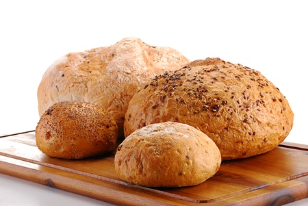 Loafs of bread and rolls isolated on white photo