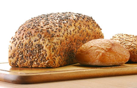 Loaf of bread and rolls isolated on white photo