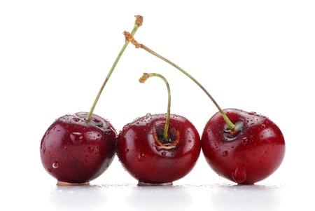 cherries isolated: Cherries isolated on white background Stock Photo