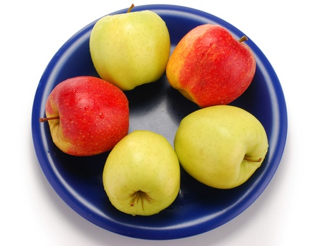 Apples on blue plate Stock Photo - 8537630