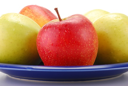 Apples on blue plate Stock Photo - 8912881