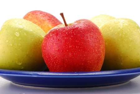 Apples on blue plate Stock Photo - 8752675