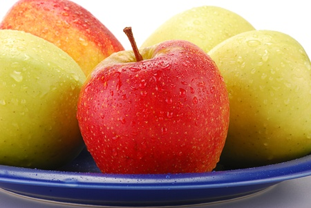 Apples on blue plate Stock Photo - 8537637