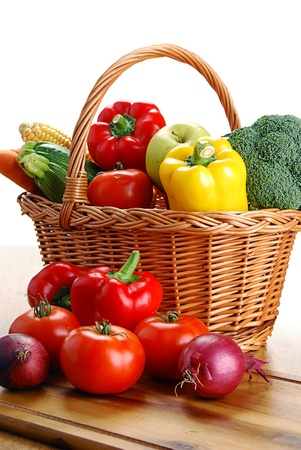 Composition with vegetables and wicker basket photo