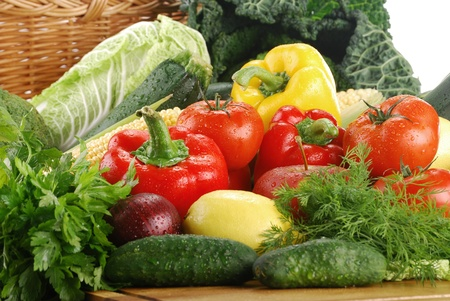 Composition with fresh vegetables and wicker basket Stock Photo - 8508362
