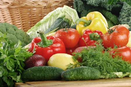Composition with fresh vegetables and wicker basket Stock Photo - 8611969