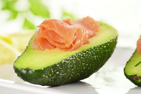 digest: Avocado with salmon on white plate