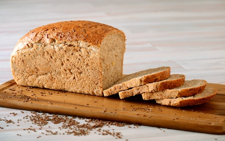 bakery products: Loaf of bread on breadboard