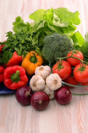 Raw vegetables on kitchen table photo