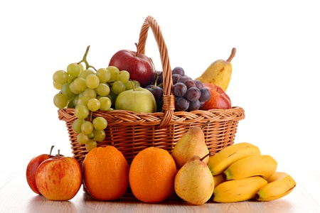 Wicker basket with fruits isolated on white Stock Photo - 8752737