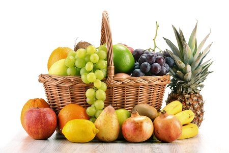 Fruits in wicker basket isolated on white Stock Photo - 8752745
