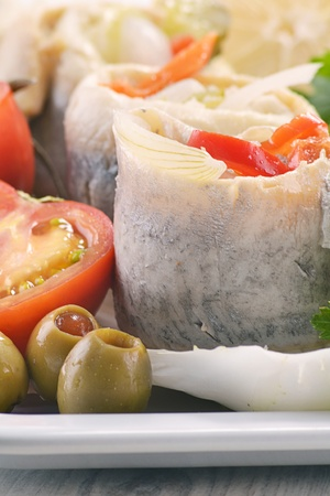 Pickled herring rollmops with vegetables photo