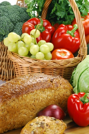 bread basket: Composition with bread and vegetables Stock Photo