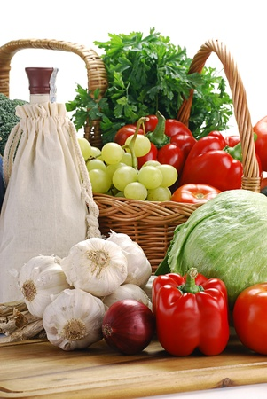 Composition with raw vegetables and wicker basket on kitchen table Stock Photo - 8695763