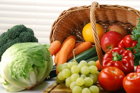 Composition with raw vegetables and wicker basket on kitchen table Stock Photo - 8752777