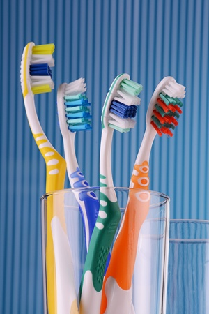 Toothbrushes on blue background  photo