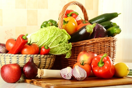 Composition with raw vegetables on kitchen table Stock Photo
