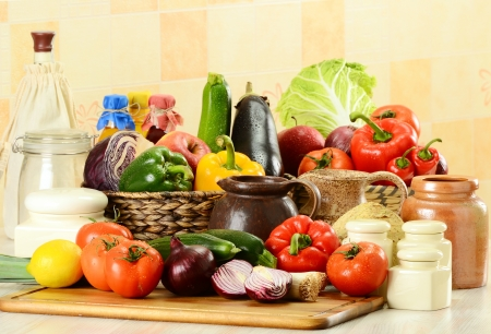balanced diet: Composition with raw vegetables on kitchen table Stock Photo
