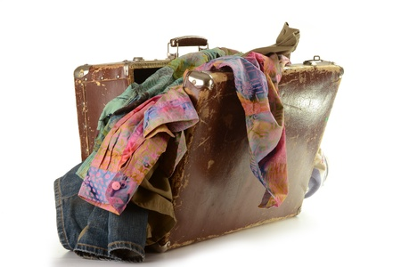 Old suitcase and clothes isolated on white Stock Photo - 9083089