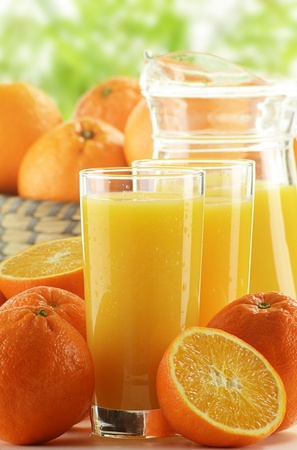 Glasses of orange juice and fruits Stock Photo