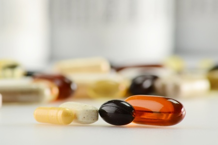 prophylactic: Composition with containers of dietary supplements and capsules