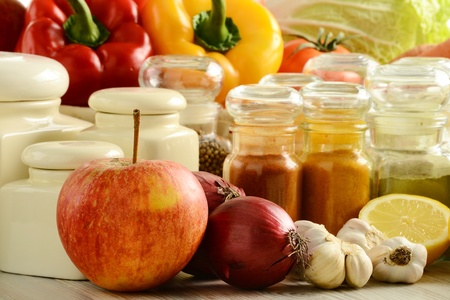 Composition with variety of spices and vegetables on kitchen table  photo