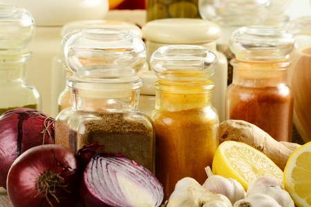 Composition with variety of spices on kitchen table  photo