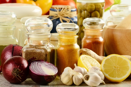 Composition with variety of spices and vegetables on kitchen table Stock Photo - 9150101