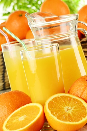 digest: Glasses of orange juice and fruits Stock Photo
