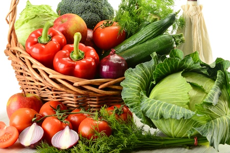 Composition with raw vegetables and wicker basket Stock Photo - 9110248